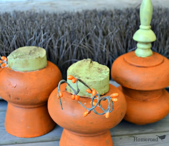 Three painted bundt feet pumpkins