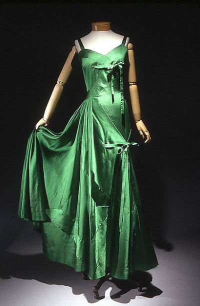 Emerald Green evening gown displayed on mannequin designed by Gilbert Adrian 1950