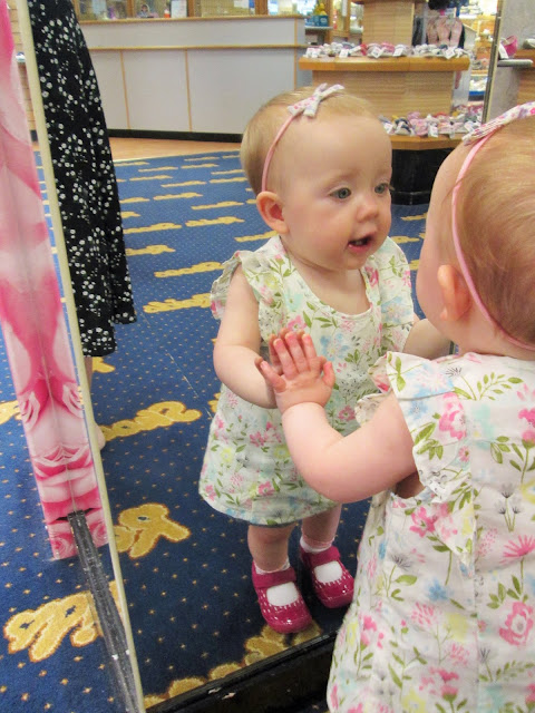 Project 365 7th June - Baby S looking in the mirror at herself with her first pair of shoes on.