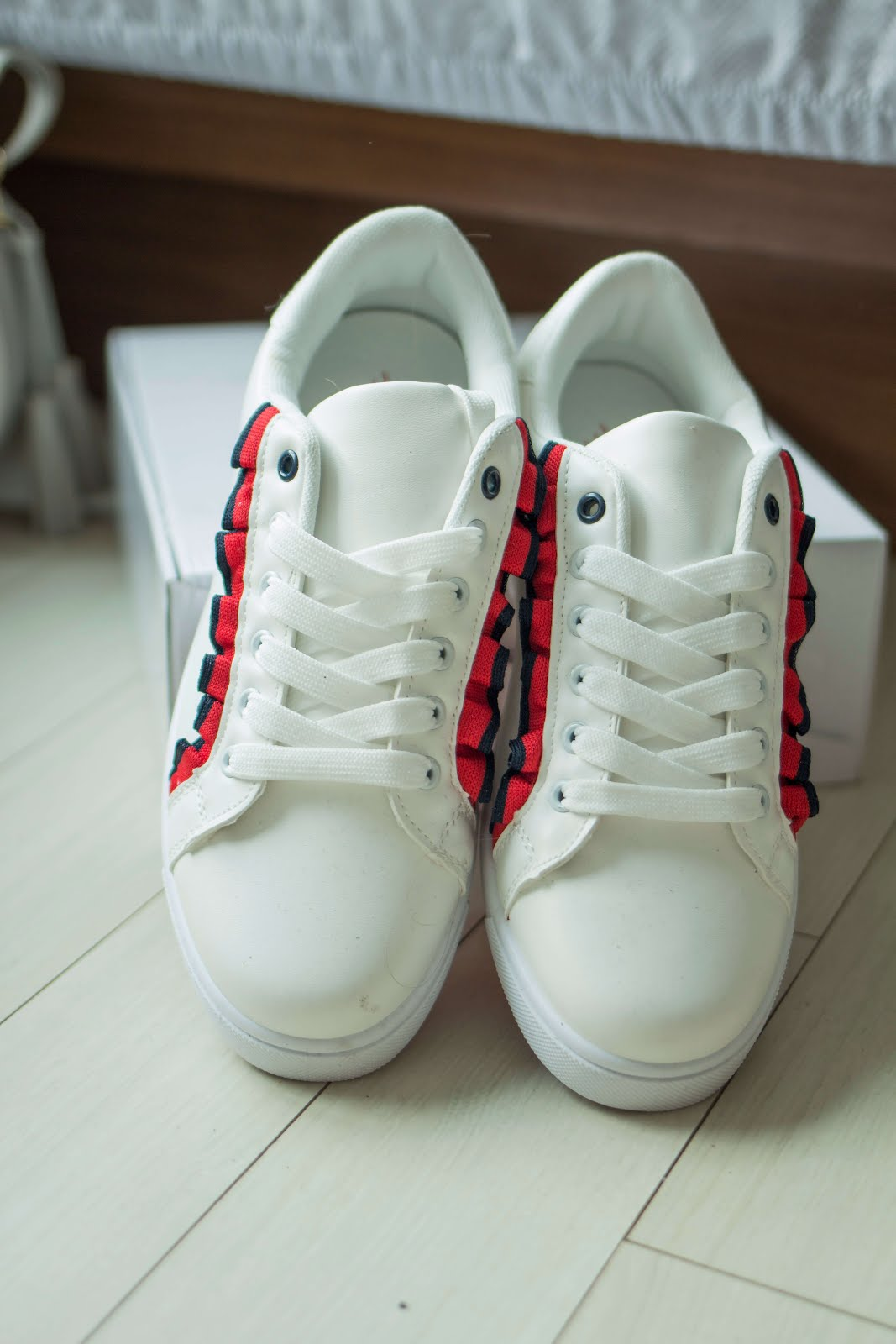 white dupe trainers red blue frill trim