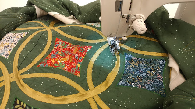 Moonrise quilt by Slice of Pi Quilts with bias tape circles