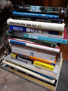 A stack of books I chose to give away.