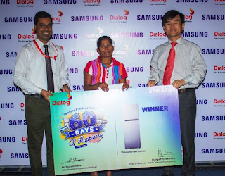 Prize winner, Anusha Kumari with Youngmin Shin - Managing Director of Samsung in Sri Lanka and Asanga Priyadarshana - Head of Business, Mobile Telecommunications, Dialog
