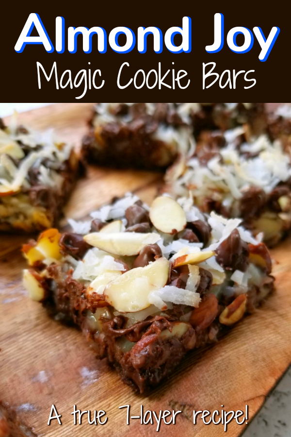 Almond Joy Magic Cookie Bars! A true spin on the original classic recipe for Seven Layer Hello Dolly Magic Cookie Bars (or whatever your family calls them!) with almonds, chocolate chips, coconut and chocolate graham cracker crumbs that Almond Joy fans will love! #almondjoy #magiccookie #7layer #sevenlayer