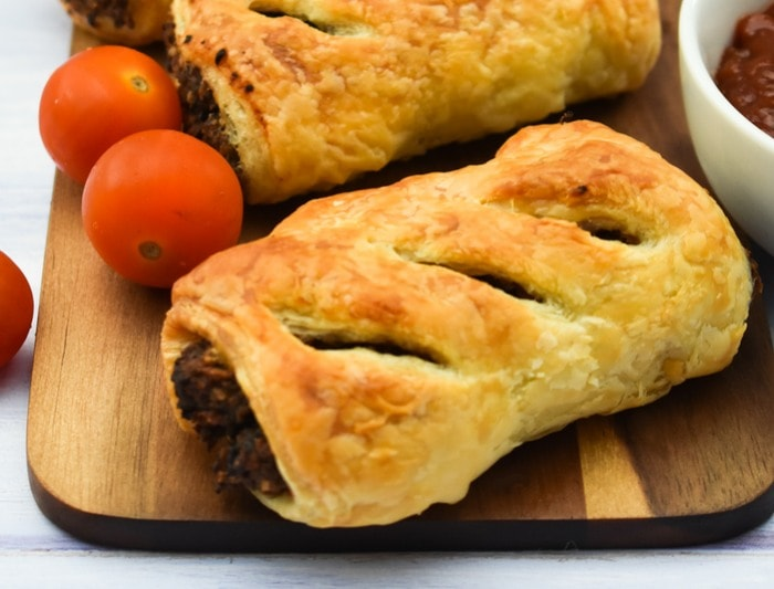 Close up of Mushroom & Chestnut Sausage Rolls and cherry tomatoes