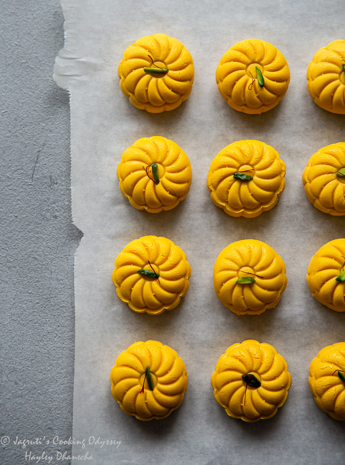Overhead shot of mango peda on parchment paper.