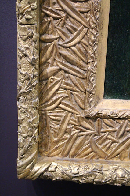 Corner of an elaborately carved Art Nouveau picture frame, gold-gilded wood with floral carving
