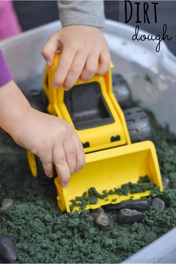 Make mold-able dirt dough for kids using this easy play recipe! #dirtdough #dirtdoughrecipesensoryplay #makedirtforkids #playdoughrecipe #activitiesforkids #growingajeweledrose