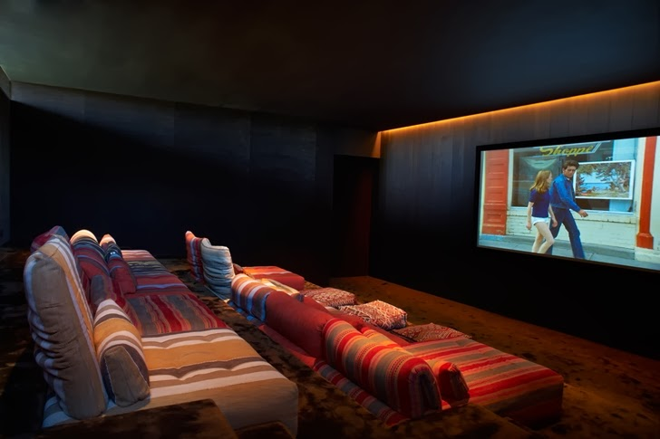 Home theater in Modern Mansion in Southampton by Sawyer and Berson