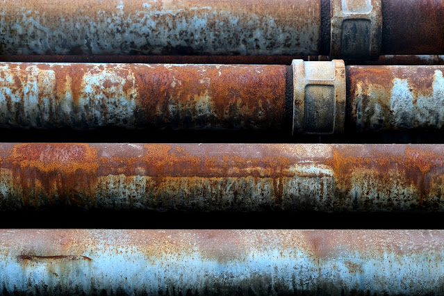 large rusty pipes