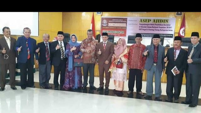 Asep Ajidin  Tenaga Ahli  Bupati Solok lulus Promosi Doktor Sangat Memuaskan