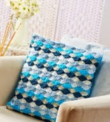 http://www.letsknit.co.uk/free-knitting-patterns/fan-stitch-cushion