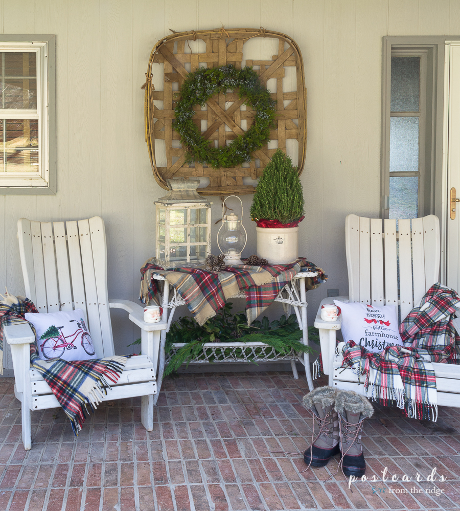 Christmas front porch decor with vintage tobacco basket, lanterns, rosemary topiary