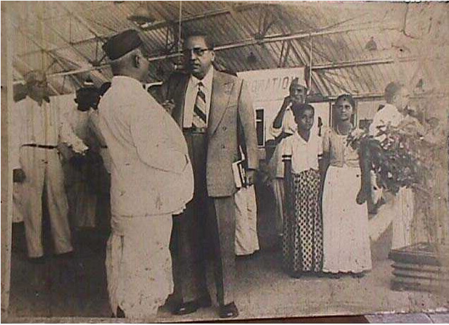 Dr. Ambedkar with Mr. Shantaram Annaji Upshyam Guruji at the railway station, Bombay. Guruji was the secretary of the Bombay Scheduled Caste Improvement Trust founded by Dr. Ambedkar. He was the manager of the newspaper Janata started by Dr. Ambedkar at Bombay