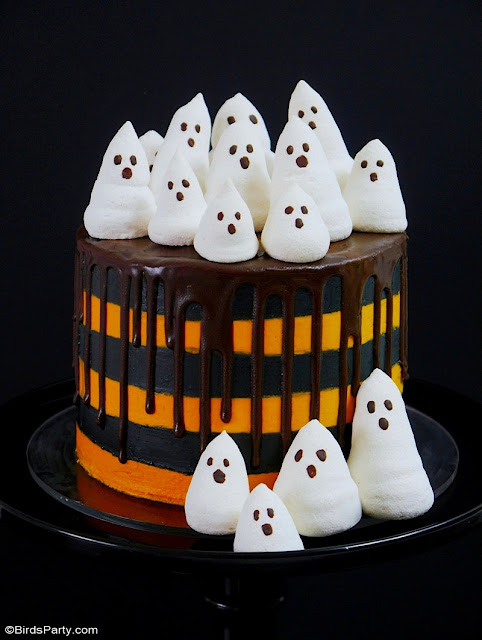 Halloween Chocolate Orange Layer Cake with Meringue Ghosts with Chocolate Drip - delicious dessert to serve at your Halloween party! by BirdsParty.com @birdsparty #halloween #halloweencake #layercake #chocolateorange #halloweenlayercake #dripcake #meringueghosts #ghosts #meringue #recipe #halloweenrecipe #chocolateorangecake #blackorange #blackorangehalloween