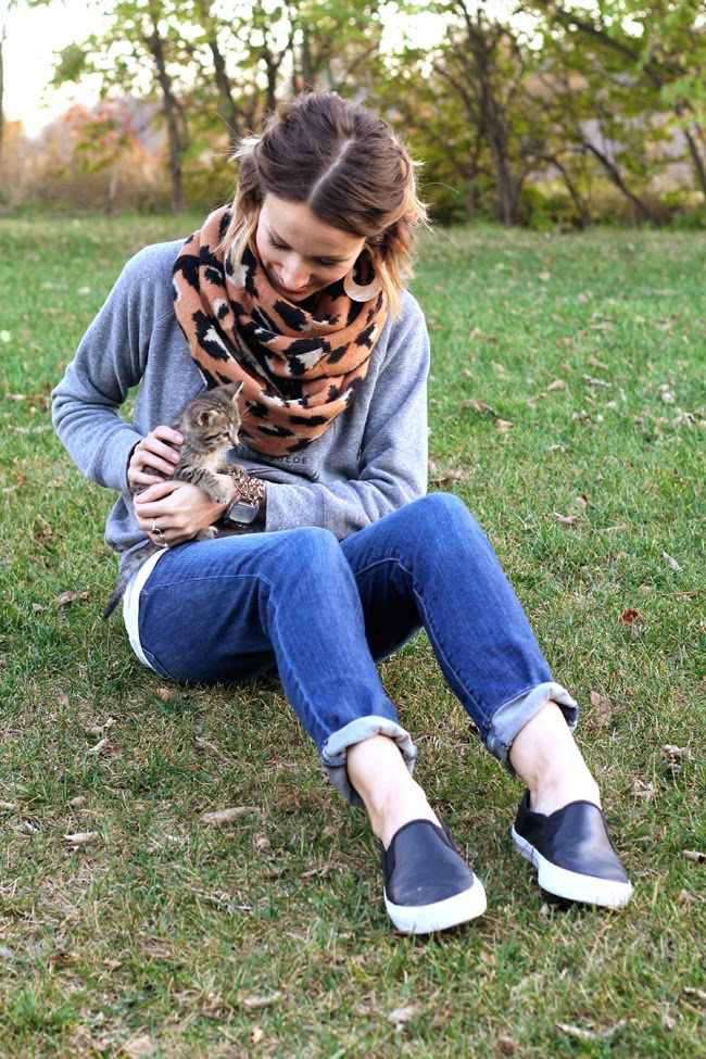 Nickel & Suede leopard scarf, gray sweatshirt and black slip on sneakers