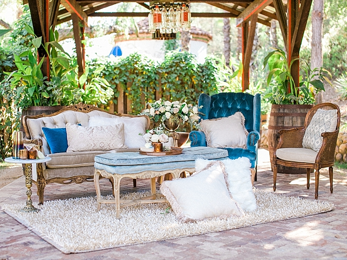 Chic blue and white lounge seating area with shaggy rug and pillows | Photo by Dennis Roy Coronel | See more on thesocalbride.com