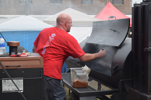 Mopping meat at the 2019 Praise The Lard BBQ Contest