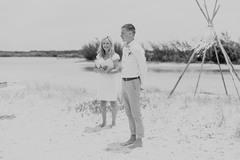 groom on beach aisle