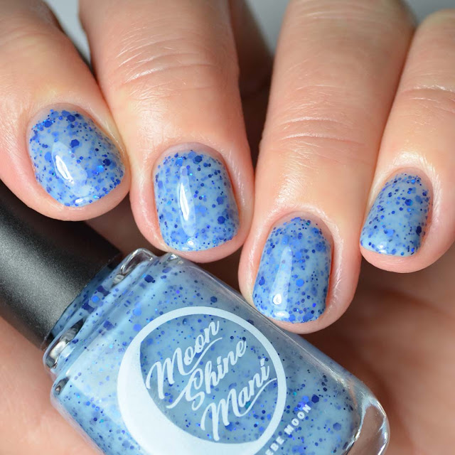 light blue nail polish with blue glitter four finger swatch