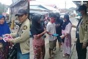 Lawan Covid-19, PDPM Minahasa Tenggara Berbagi Masker di Pasar Belang