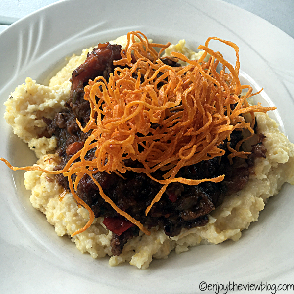 grits dish with sweet potato straws