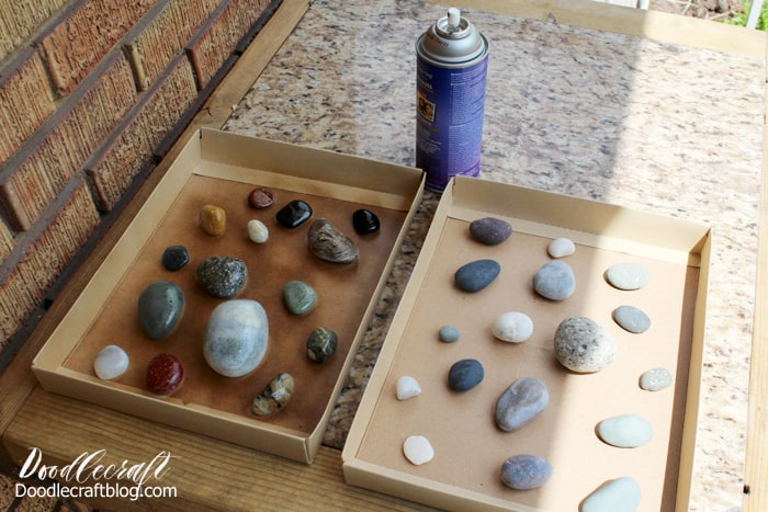 Spraying rocks with resin spray to make them shiny