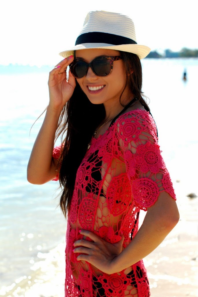 Wearing a Red Crochet Beach Cover up with Trend Animal Print Sunglasses and White Hat