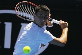 Tomic's return to court ends early in France