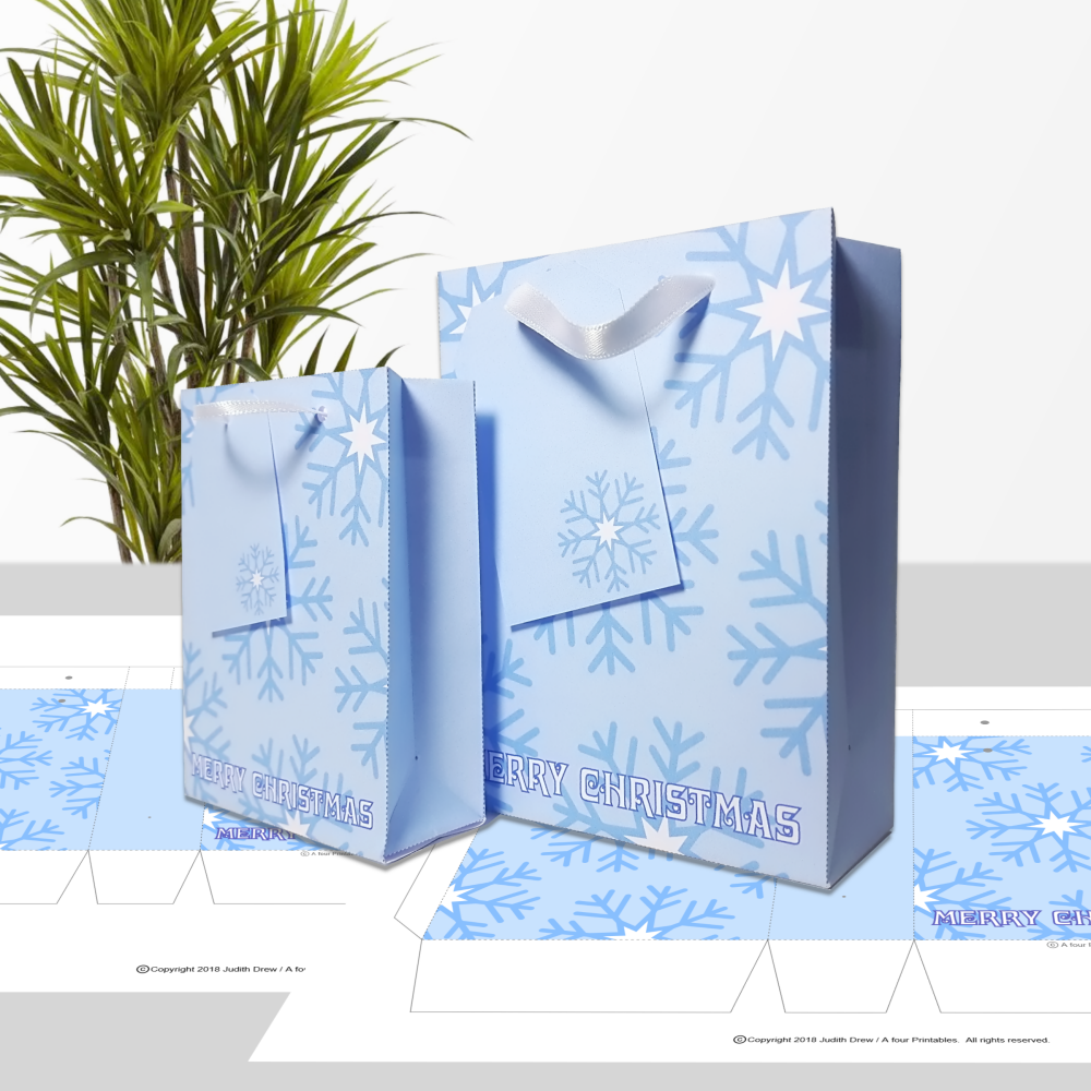 Blue snowflakes Merry Christmas gift bags and matching tags from A four Printables.