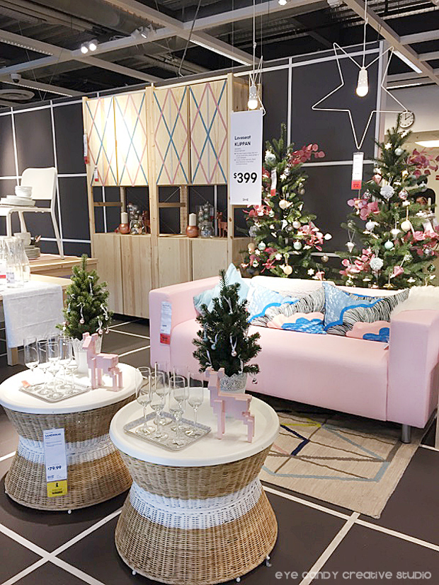 pink couch, pastle christmas decor at IKEA, christmas tree, wicker table