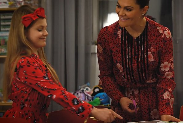 Crown Princess Victoria wore a floral dress from Zadig & Voltaire. Princess Estelle wore a red floral print blouse and asymmetric skirt