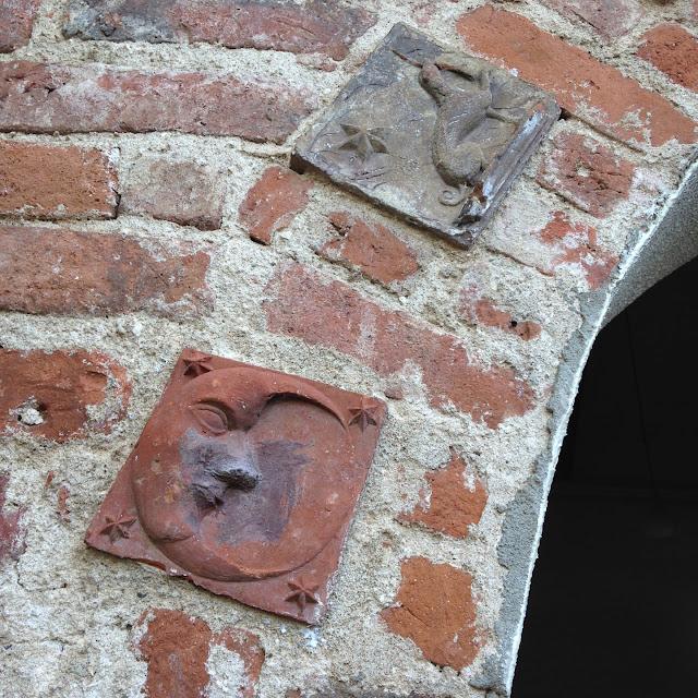 Dupax church exterior decorative brick religious symbols arched portals