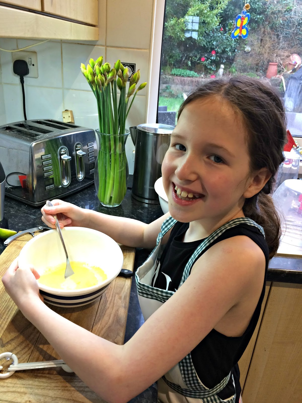 Caitlin Hobbis whisking eggs in a bowl at home in the kitchen