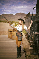 Wild Wild Weird West Steampunk Cowgirl costume with cowboy hat and gun. how to recreate this look