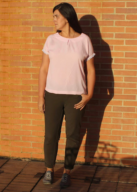 A pink crepe top made from the Avid Seamstress Drop-Sleeved Top sewing pattern.