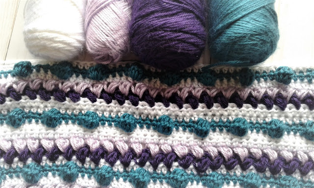 purple white and teal blanket