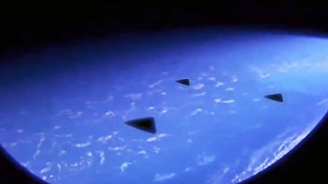 Three triangle shape crafts speeding past the ISS caught on camera.