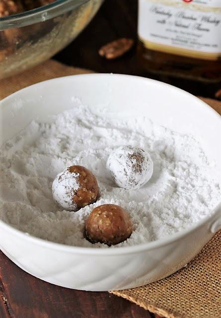 Rolling Kentucky Bourbon Balls in Powdered Sugar Image