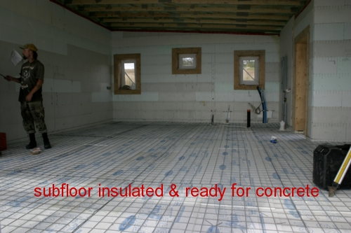 In floor heating with insulation  over the tubing and ready for concrete pouring.