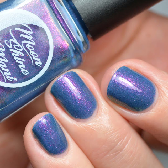 blue nail polish with color shifting shimmer swatch