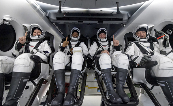 The Crew-1 astronauts take one last group photo aboard Resilience before disembarking from their capsule for the return trip back to Houston, Texas...on May 2, 2011.