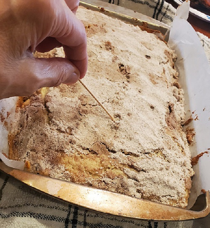 this is coffee cake cooling showing the toothpick method that it is cooked all the way through