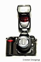 Cramer Imaging's professional quality product photograph of a Nikon DSLR camera with removable flash unit