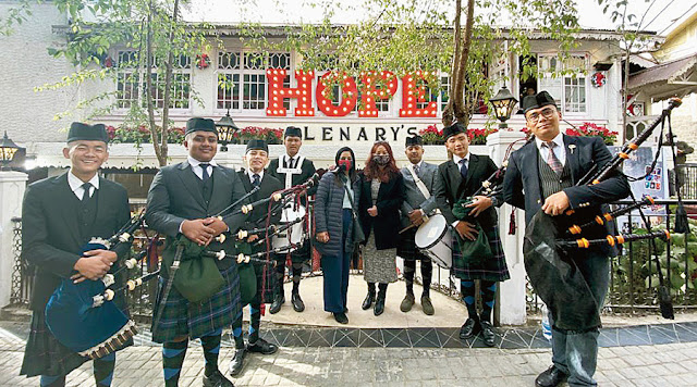 A band plays the message of hope in front of Glenary's in Darjeeling