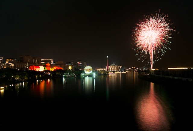 Fireworks light up the Putrajaya lake during Night Glow