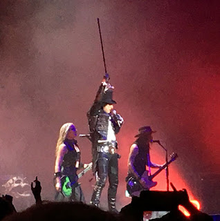 Alice Cooper on stage with two guitarists