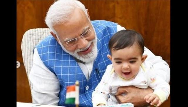 मोदी जी के साथ वायरल हो रही इस बच्चे की तस्वीर में जाने यह बच्चा किसका है और कौन है?