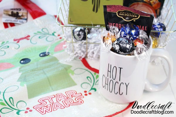 "Fill the mug with candy! Write ""This is the Way"" inside the card! Roll up the baby yoda stocking and stuff them all inside a wire basket from the dollar store."