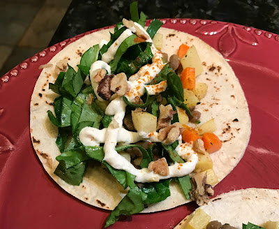 Lentil Taco with Roasted Root Vegetables, Lightly Dressed Spinach, and Feta-Yogurt Sauce